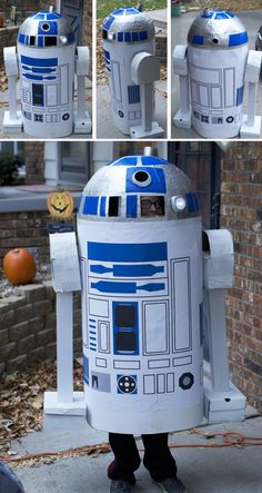 R2D2 (from Star Wars) homemade Halloween costume made from paper mache and cardboard   How it was done: paper mache the top of a yoga ball with multiple layers, spray paint with silver, use blue Sharpie and/or blue painter's tape, circle made from lemonade container, shoe boxes for feet, cardboard pieces for arms, poster board wrapped for body. Added a battery powered push light for fun and a cell phone inside to make noises. (installed shoulder straps and circle PVC pipe inside)