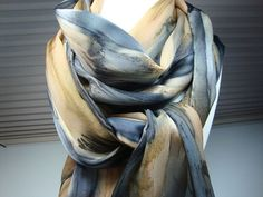 This gorgeous streaked scarf is hand painted and is 100% silk. Hand hemmed as well. Striking! Lovely mixture of black, antelope, and brown dripping into each other to create a lovely picture for you to wear with your favorite outfit. Imagine this one on a winter white, khaki, gold, or