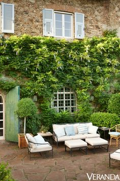 A centuries-old wisteria vine drapes the pergola and covers the terrace wall of a 16th-century terrace wall.