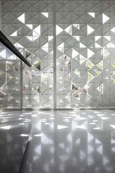 Light and movement can be glimpsed through triangular openings in the white aluminium facade of House, a Tel Aviv home by Pitsou Kedem Architects. Partition Design, Facade Design, Wall Design, House Design, Architecture Paramétrique, Pattern Architecture, Chinese Architecture, Futuristic Architecture, Sustainable Architecture