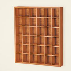 """Product #HC2491 - Shot glass curio holds up to 36 jiggers! Store and display your collection in this handsome showcase. Attractively finished wooden rack has 6 - 2-1/2"""" high shelves for showing off your favourite shot glasses. Mounts easily on wall with included hang hooks. $29.98"""
