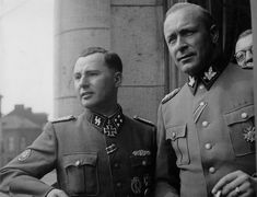 "The commander of the 5th SS Volunteer Assault Brigade ""Wallonia""  SS Sturmbannfuhrer Leon Degrelle (left) and  Gruppenfuhrer SS senior SS and Police Leader in Belgium and Northern France Richard Jungclaus in Charleroi, Belgium on Jan 4, 1944. Degrelle wears the Close Combat Clasp (over left pocket) the highly coveted decoration for hand-to-hand fighting. Jungclaus was KIA in Yugoslavia in 1945. Degrelle escaped to Spain and died in 1994."