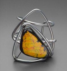 Bracelet |  Elsa Freund, 1946.  Aluminum wire, glass, terracotta, Indian ink.