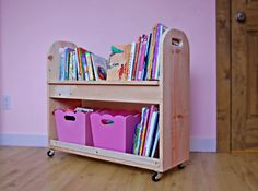 I want to make this!  DIY Furniture Plan from Ana-White.com  A rolling cart featuring a angled top book shelf perfect for keeping books in place, and a large bottom shelf perfect for baskets or bins. Sized for children.