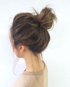 Master the messy bun with @StyleCaster's hair inspiration roundup | loose bun medium hair