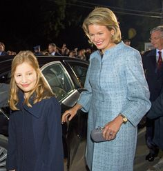 Queen Mathilde smiles as she follows her daughter, Crown Princess Elisabeth, at the First World War commemoration on Friday in Ploegsteert, Belgium, where Crown Princess Elisabeth delivered a message of peace to the huge crowd.