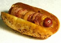 Here's my brother's fave thing to eat at the stadium... a FrankCheesie!  A cheese stuffed hotdog, wrapped in bacon and fried crispy.  I've gotta admit, they ARE good...   oh my good Lord.