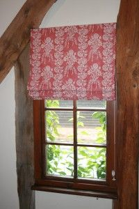 Tailored window treatment in a rustic space - nice!