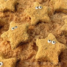 Homemade star shaped marshmallows dipped in chocolate and graham cracker crumbs are decorated to look like Starfish S'mores. Fun to serve at pool parties!