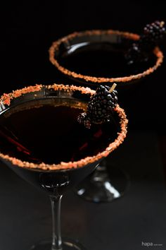 1 tablespoon sugar orange or red and yellow food coloring 1 lime wedge dark rum dry vermouth blackberries toothpicks