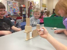 Roll & build a cooperative structure with 3D shapes.  One Lesson of many in Kindergarten Geometry Lesson Book.