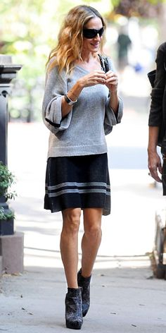 SJP in a loose sweater with a striped skirt; she accessorized with high-heeled booties and a Halston Heritage tote.