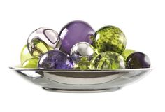 Blown glass orbs in silver tray to reflect the amazing color and texture of the glass- Worldly Goods Inc