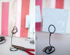 Totally want to make these for my wedding! Table holders made out of wire. Would look cute with a heart form instead of a circle too!