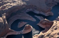 Lake Powell, which is the country's second-largest reservoir when it is at 'full pool' capacity, now has a white bathtub ring in its canyons from dropping water levels