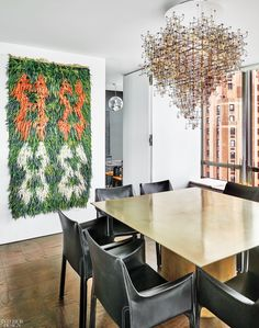 Hovering over a custom dining table in unpolished brass is a Studio Drift chandelier composed of bronze electrical circuits and dandelion seeds. Custom Dining Tables, Dining Chairs, Taupe Gray Paint, Duplex Apartment, Apartments, Ceiling Murals, Library Wall, Interior Design Magazine, Architecture Details