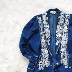 NEW LISTING Vintage Embellished Jean Jacket Ok, I'm really excited about this one! A batwing long embellished jean jacket, complete with rhinestone buttons. Some wear on the collar, but otherwise in good condition. Jackets & Coats Jean Jackets