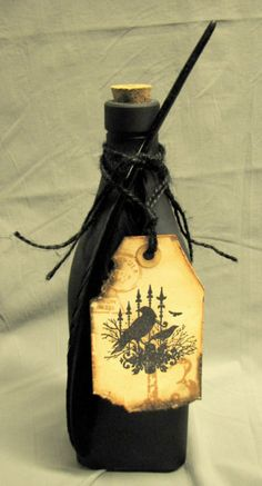 chalkboard paint, black twine, stamped burned tag bottle for Halloween décor.