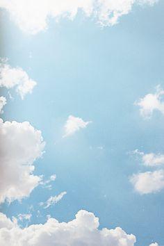 Blue Sky & Fluffy Clouds.