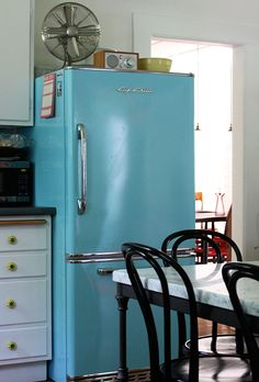 """Sneak Peek: A Massachusetts Farmhouse Where Color and Pattern Meet. """"Ah, my baby blue Big Chill refrigerator.  This, along with the matching dishwasher, was our big splurge for the kitchen.  We call it our """"fashion fridge."""" The color and style make me smile whenever I'm in the kitchen."""" #sneakpeek"""