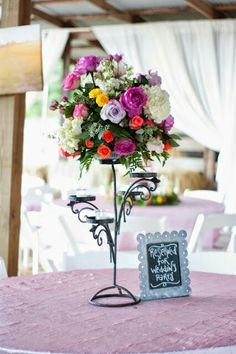 One of the centerpieces from a wedding we did last year. Moonflower Cottage.