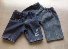 Spijkerbroek voor pop van 43 cm. Strassteentjes als applicatie. Made by me.