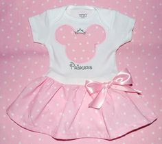 Baby Pink Minnie Mouse Onesie Dress with Ruffle Bottom and Rhinestone Personalization. $39.00, via Etsy.