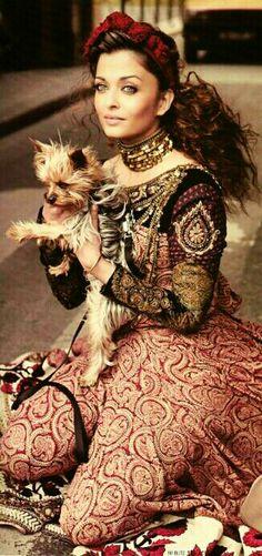 OKAY my 2 favourite things - Aishwarya holding a yorkie.