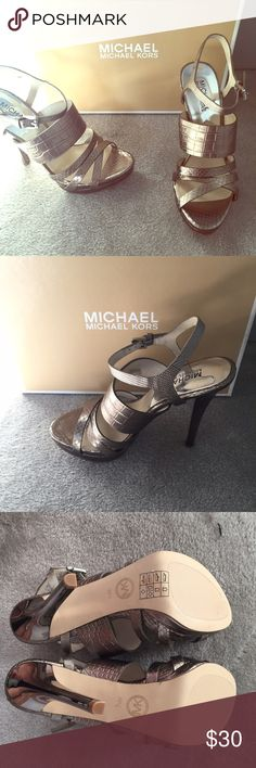 NWB Michael Kors pewter platform strappy heels Michael Kors brand pewter platform strappy heels in size 7.5. Gorgeous and classy heels that go with everything! Brand new in box! ***NO LOW BALL OFFERS PLEASE Michael Kors Shoes Heels