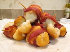 Grands Flaky Biscuit Layers stuffed with Mozzarella cheese and wrapped and fried in Bacon!