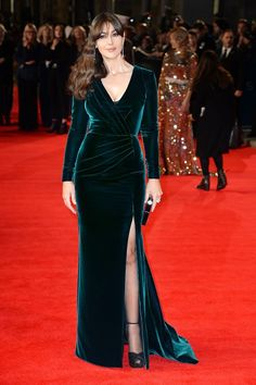 Monica Bellucci wears an emerald green silk velvet backless gown to the royal world premiere of 'Spectre', London