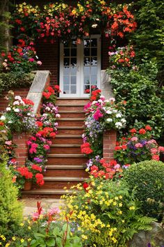 .Awwwwwesome garden path of brick steps with incredible garden plantings on either side leading up to the wonderful french doors!!!!