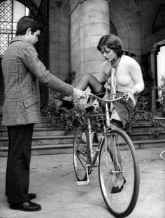 Tina Aumont with Alessandro Momo from Malizia (1973) Probably not the best way to mount your bike in mixed company. There were a group of boys watching a waiting to assist her!