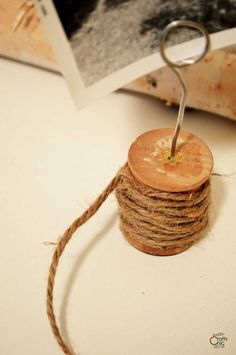 See how I upcycled a vintage bobbin spool to hold flowers with this easy wooden spool craft idea. Vintage sheet music and ribbon turned it rustic chic. Wooden Spool Crafts, Rustic Crafts, Wooden Spools, Vintage Crafts, Rustic Chic Decor, Rustic Shabby Chic, Vintage Sheet Music, Vintage Sheets, Homemade Storage