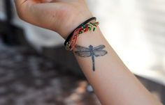 blue dragonfly tattoes on the wrist | funky dragon fly on the wrist is just the way to be