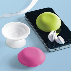 Simply wrap your earbud cords around one of these colorful Macaroon Earbud Holders and suction it to your mobile phone, iPad®, tablet or any smooth surface.