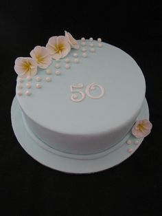 Mum's 50th Birthday Cake - a 20cm (8 inch) round dark fruit cake, iced and decorated with hand made fondant pearls and frangipanis.     Let get some ideas for tonight dinner, what do you think about this?