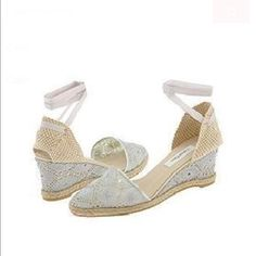 Calvin Klein Ella Silver Metallic Put a sparkle in your step with this darling wedge. Metallic lace upper. Sexy wrap-around grosgrain ribbon ankle ties. Fabric lined footbed. Espadrille accent on midsole. Logo embossed rubber sole.  Worn once to house party never outside practically new Price is firm no rush to get rid of them Calvin Klein Shoes Wedges