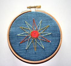 #30DOC Day 5: Embroidered star on recycled fabric framed in an embroidery hoop