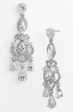 Glittering pavé crystals and stunningly clear stones brighten these elegant chandelier earrings.