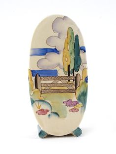 ~ 'Stile and Tree' a Clarice Cliff Bon Jour sugar sifter, painted in colours 12.5cm. high...