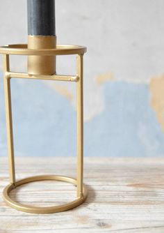 Gorgeous geometric minimal candle holder in gold coloured brass effect. H 13cm x D 7cm