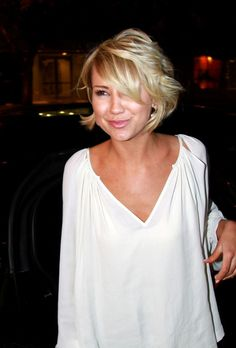 cute curled short hair- I wish I had the balls to chop it all off