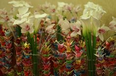 Cymbidium orchid, cala lily and crane table centres. Cala Lilies and cymbidium orchids available for Scottish brides in February. Contact The Stockbridge Flower Company for more details.