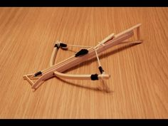 In this video we teach you how to make a mini crossbow with coffee shop sticks.This mini gun shoots up to 10 meters!
