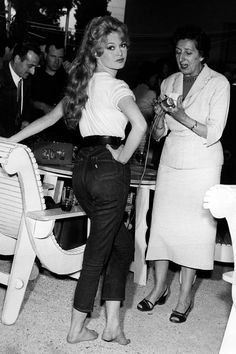 Brigitte Bardot's trick? Tucking in her tee and rolling up her sleeves. #refinery29 http://www.refinery29.com/celebrity-denim-outfits#slide-28