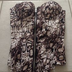 Zip up Snake Skin Top with Tags Snake skim black brown & white strapless top. Also could be worn with straps. Zips from bottom to to top. NEVER WORN Charlotte Russe Tops
