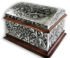 Embossed (repousse) jewelry boxes. There are many measures and a great variety of motifs and designs based in historical ornaments from all ages and my own designs. Like in all my works you can cho...