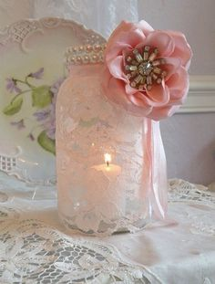Beautiful lace and pearl mason jars for a bridal shower or wedding decor, but with a purple flower or ribbon instead.might be changing up my centerpieces again. - wish-upon-a-wedding Lace Mason Jars, Mason Jar Crafts, Estilo Shabby Chic, Bridal Shower, Baby Shower, Girl Shower, Mason Jar Centerpieces, Ideias Diy, Bottles And Jars