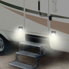 Sometimes when we leave our RV, I forget to turn on the outside lights for when we return in the dark. I mounted two solar deck lights on either side of the steps that adhere with hook-and-l…